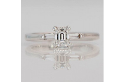 Emerald Cut Solitaire With Diamond Shoulders